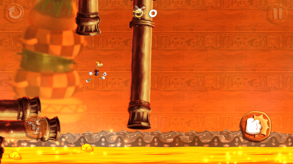 Rayman leaps for his life — that molten liquid looks hot!